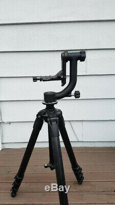 Italian Manfrotto Carbon Fiber tripod topped with Smooth opertating Wimberley Head
